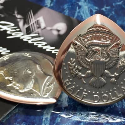 The Highland Plectrum Co. One USA Half Dollar Coin Plectrum.