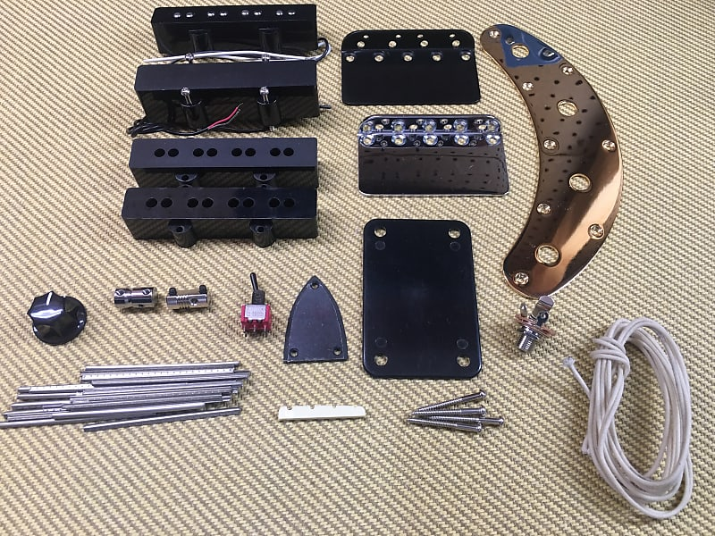 assorted bass guitar parts lot pickups control plates wire reverb. Black Bedroom Furniture Sets. Home Design Ideas