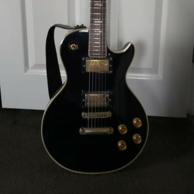 Jedson Single Cut Copy 1974 Black with ivory trim & mother of pearl fret inlay for sale