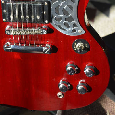 Epiphone Celtic SG G-400 in Cherry Red w/new Celtic pick guard, and many extra's. And like new HSC