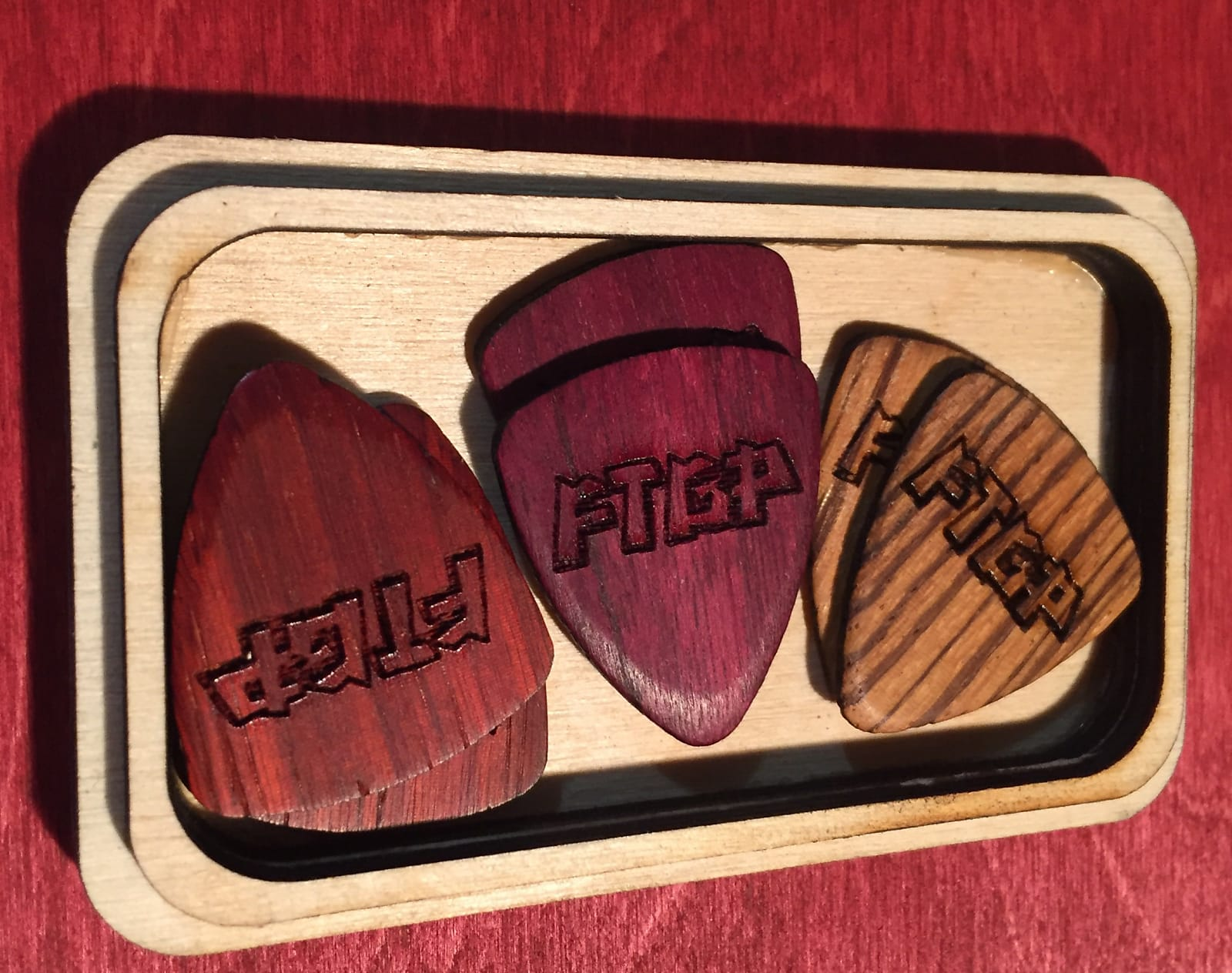 USA made exotic purpleheart, padauk and zebrawood picks in handmade laser engraved wood box