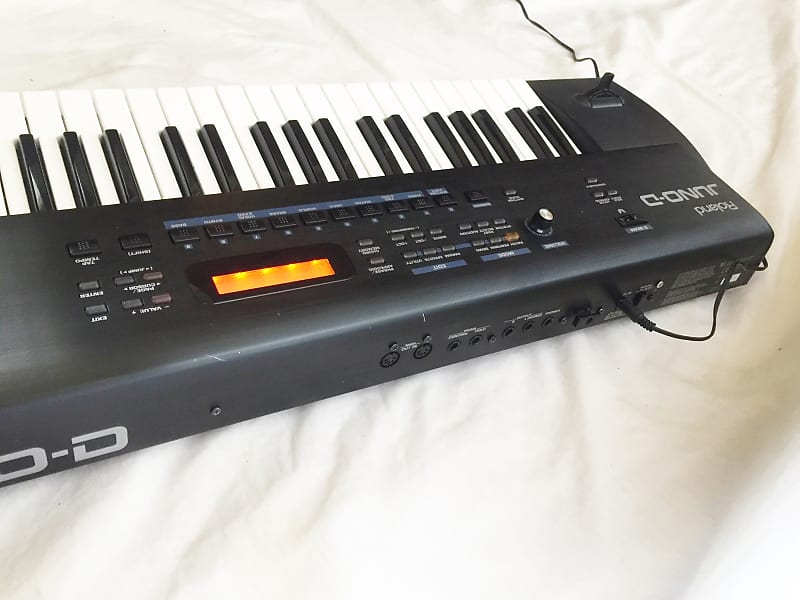 ROLAND JUNO-D Synthesizer 61-Key Keyboard  Sounds and Works Great !