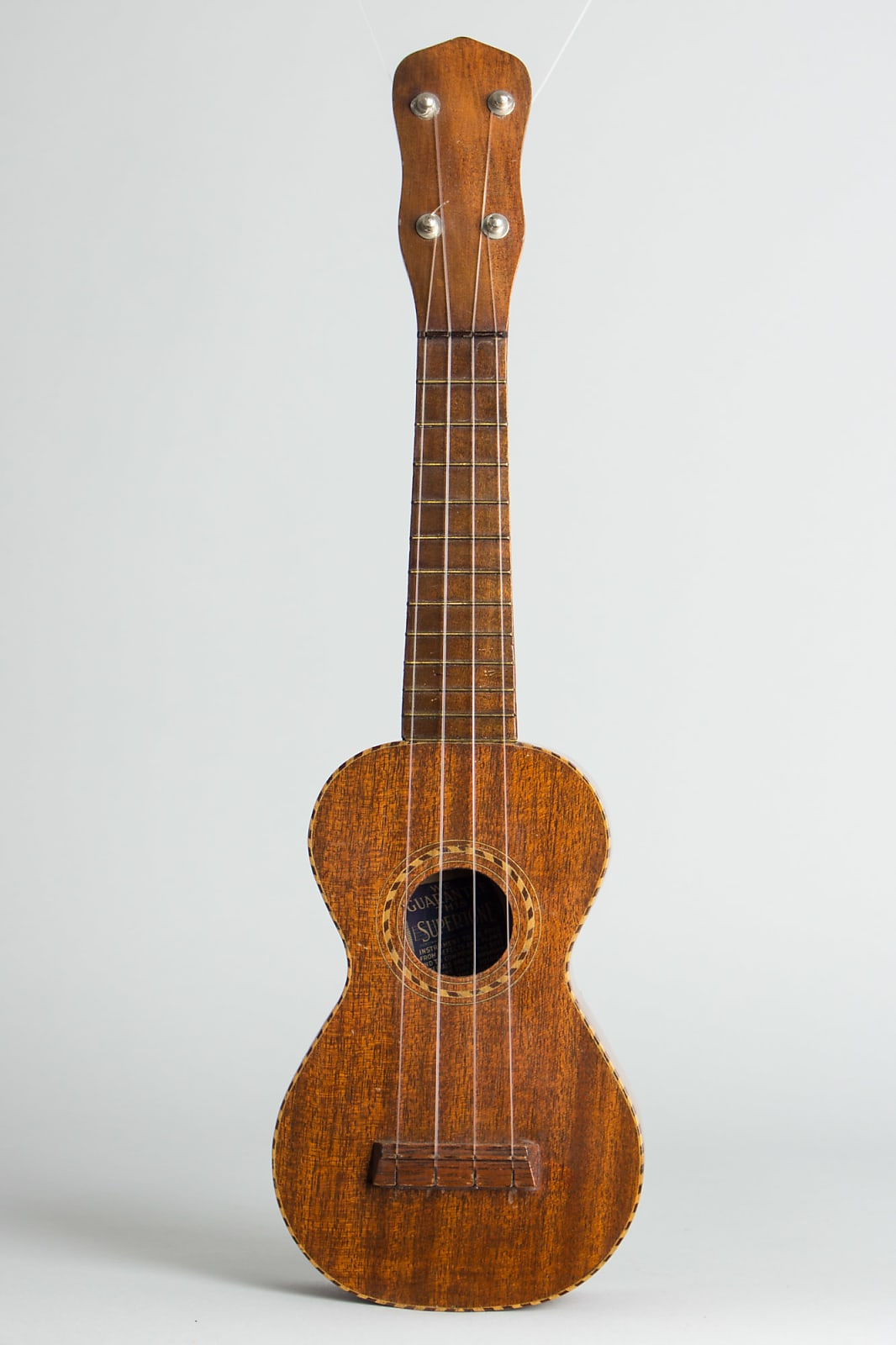 Supertone Soprano Ukulele, made by Harmony,  c. 1920, original canvas soft shell case.