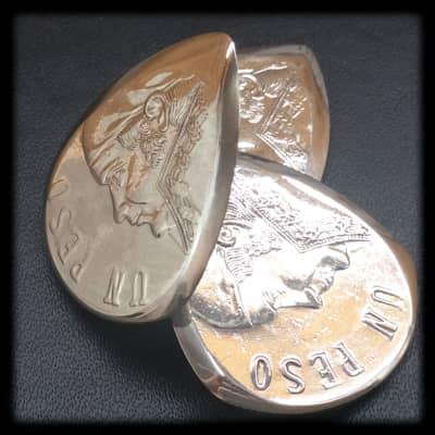 Handmade Guitar Pick. Mexican Un Peso Coin Plectrum. image
