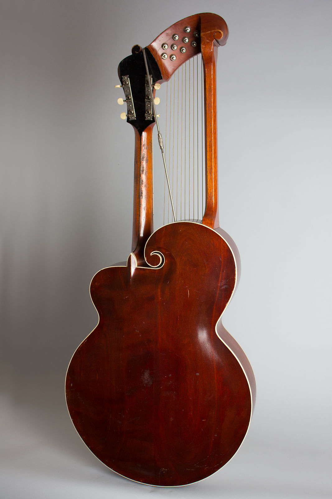 Gibson Style U Harp Guitar 1917 Sunburst top, cherry stained back and sides, original case.