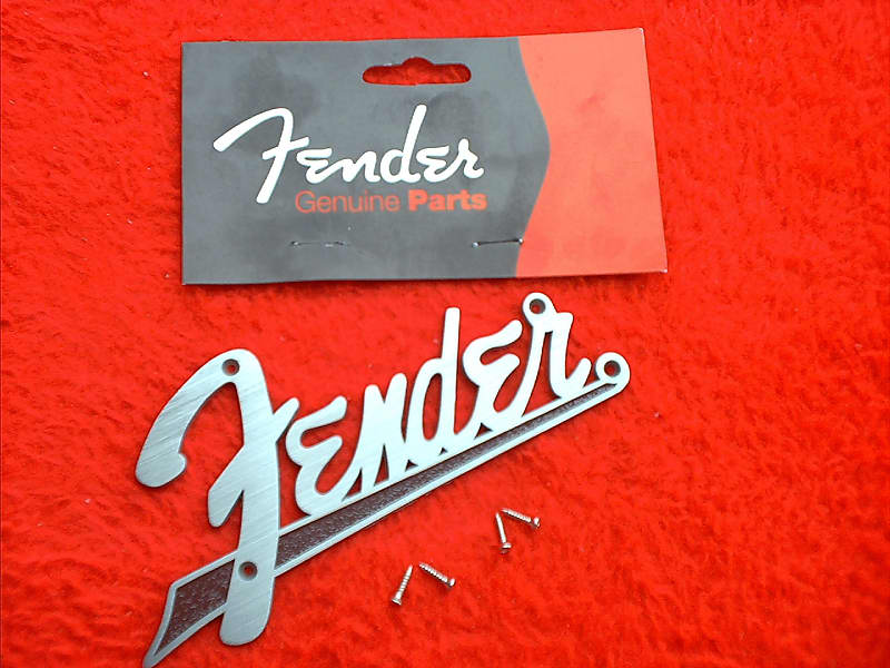 A NEW GENUINE FENDER METAL AMP LOGO WITH A BLACK TAIL 099-4093-000