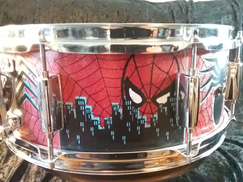 Mapex Assaulted Battery custom Spider-man themed graphics over a red sparkle finish. custom Spider-man multi layer