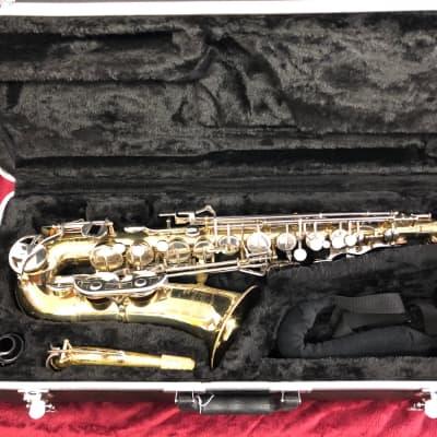Selmer Bundy II Alto Saxophone, w new case.