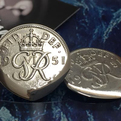The Highland Plectrum Co. One Brian May Inspired 1951 Sixpence Coin Plectrum.